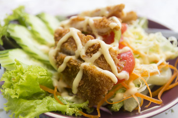 batter fried fish with salad