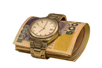 A roll of nigerian money are inserted into a watch