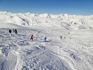 Skiers on a ski slope, the Alps, France