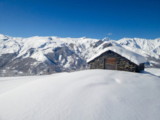 Picturesque traditional cabin in the Alps in winter