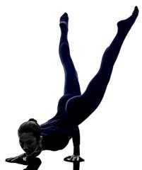 woman exercising Mayurasana peacock pose yoga silhouette