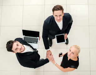 Business meeting. Top view of three business people in formalwea