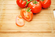 Fresh Organic Tomatoes on a Wooden Cutting Board