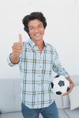 Portrait of a football fan gesturing thumbs up