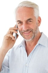 Smiling mature man using mobile phone