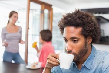 Handsome man enjoying his coffee