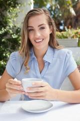 Beautiful woman having a coffee