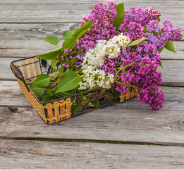 Basket with a branch of lilac