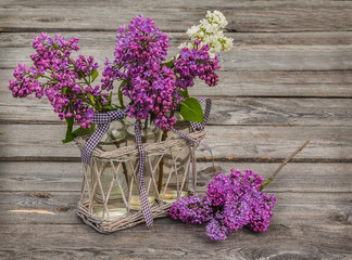 Purple-blue lilac  on a wooden  table