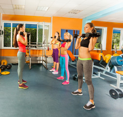 Young women exercising with dumbbells