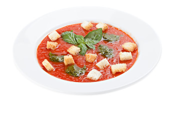 Bowl of tomato soup with croutons