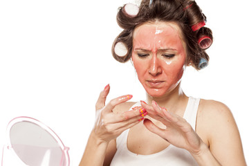 nervous woman with a mask on her face clean her nails