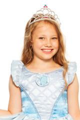 Close portrait of girl in dress wearing crown