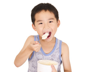 Boy eat milk ice cream