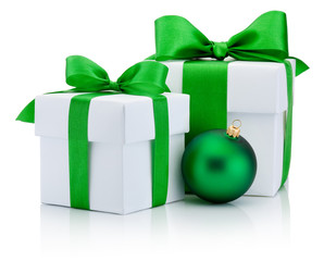 Two White boxs tied green satin ribbon bow and christmas ball Is