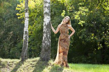 Beautiful blonde in leopard print long dress
