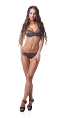 Sexy model advertises brown polka dot lingerie