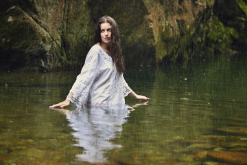 Beautiful woman in forest stream