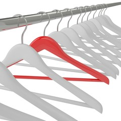 White and red clothes hangers isolated