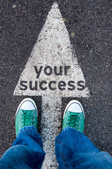 Green shoes standing on your success sign