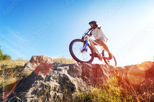 canvas print picture Mountain biker in action