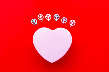 heart shape with peace icon on red background