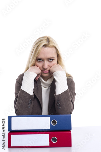 canvas print picture Frau ist im Büro überarbeitet und müde