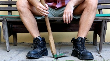 gardener resting on a bench