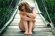 Постер, плакат: Портрет красивой грустной девушки на мосту