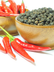 Red chili pepper and black pepper spicy isolated on white backgr