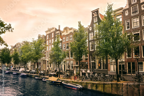 canvas print picture boats and bikes in amsterdam