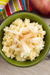 Portion of sweet millet porridge with apple and cinnamon