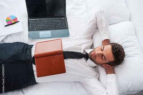 Businessman sleeping.
