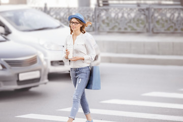 Crossing the street.