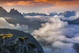 Foggy summer sunrise in the Italian Alps. Dolomites mountains, I