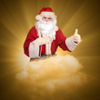 Santa Claus flying on the cloud.