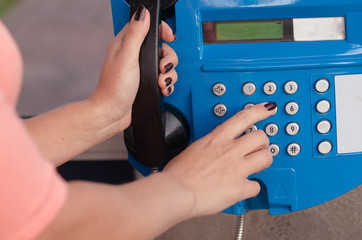 hand of woman dialing a telephone