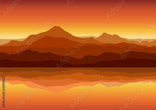 Sunset in huge mountains near lake