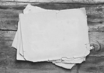 of old papers on wooden background