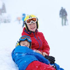 Two happy boys enjoying skiing