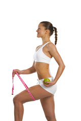 young attractive woman with measuring tape