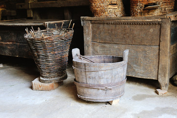 Wooden bucket and wicker basket in the shed