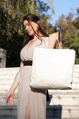 Woman leaving the mall with shopping bag.