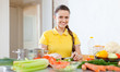happy woman cooking   salad at  kitchen