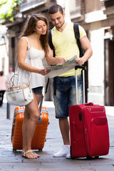 Couple with map on city streets