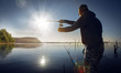 man fishing on a lake - 69904433