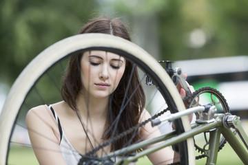 Woman repairing her bicycle