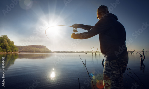 Tuinposter Vissen man fishing on a lake