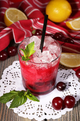 Fresh cold cherry cocktail with mint, ice and lemon