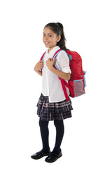 sweet happy hispanic little girl smiling with schoolbag